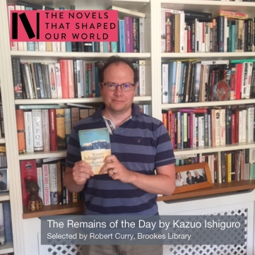 Robert Curry from Oxford Brookes library holding a copy of The Remains of the Day by Kazuo Ishiguro