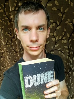 Dan Croft holding a copy of Dune