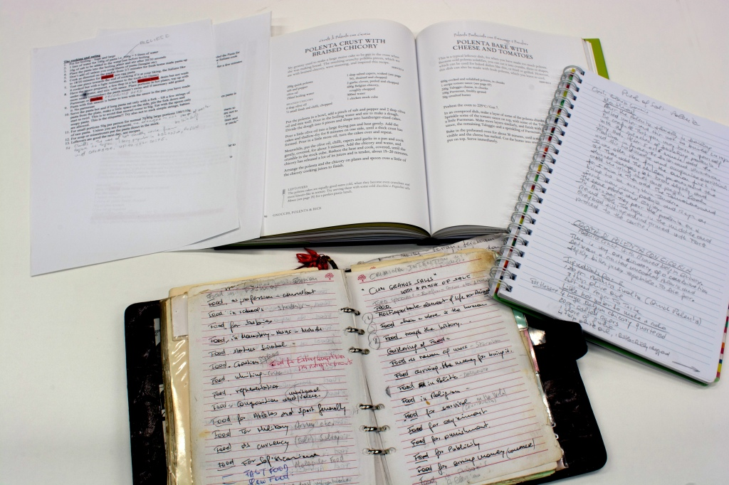The published book 'Simple cooking' with handwritten notebooks alongside